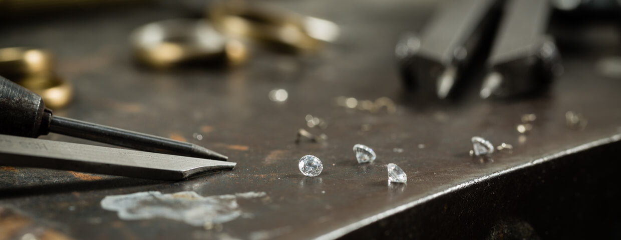 Working desk for craft jewelry making with professional tools. Still life of goldsmith's tools with diamonds.