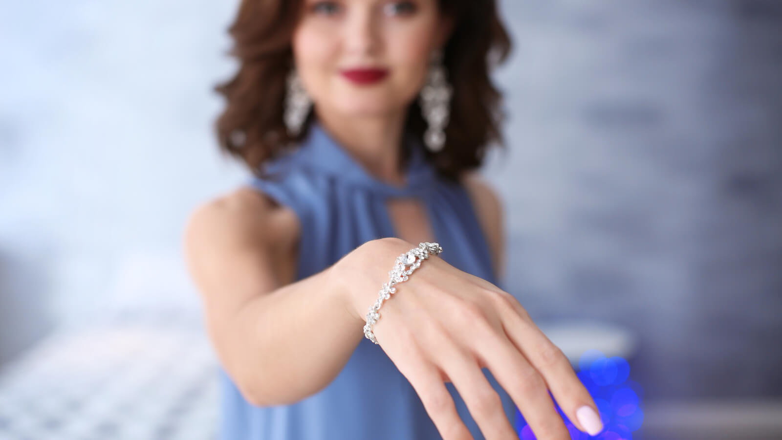 Young woman showing her beautiful diamond bracelet