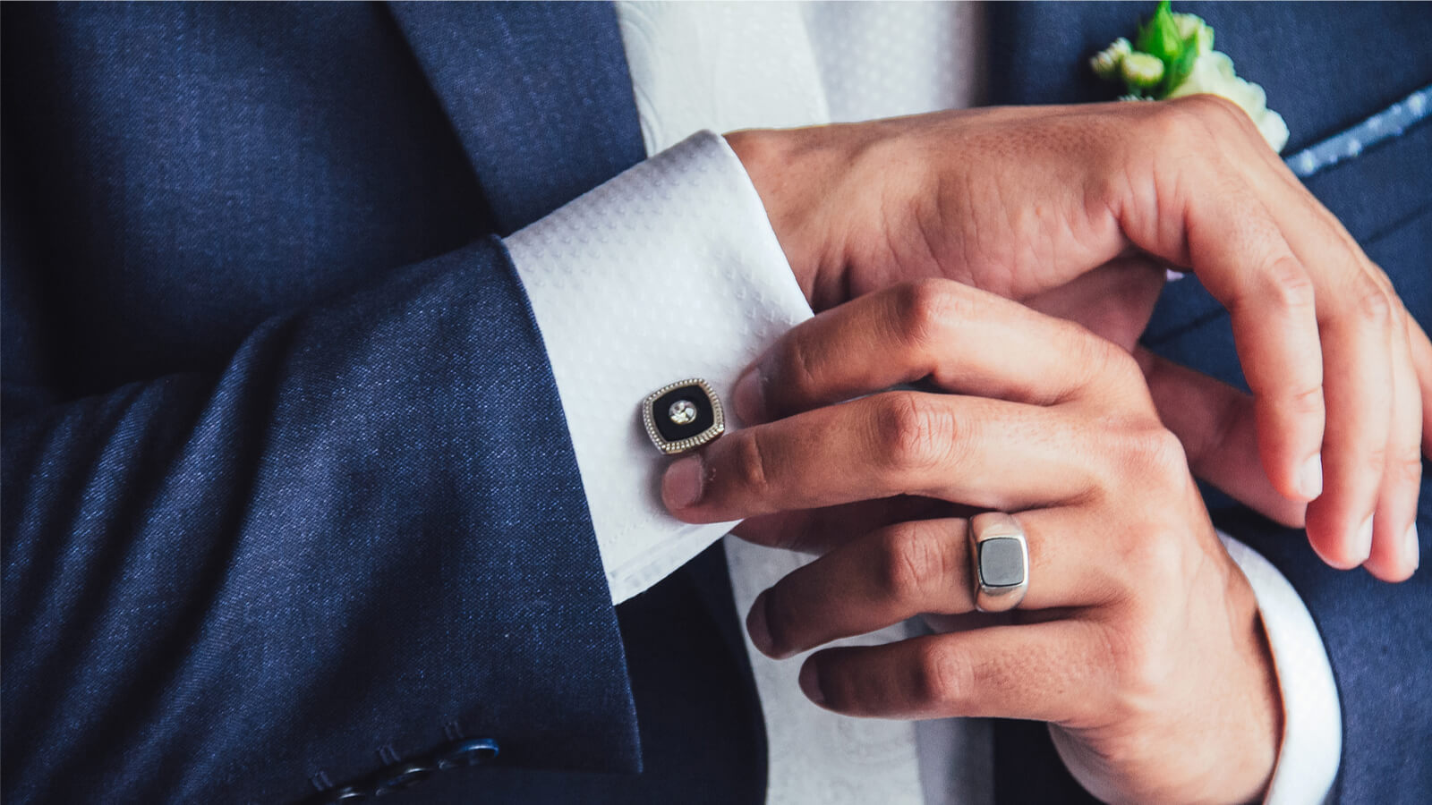 elegant young fashion man fixing cufflinks, man wearing wedding ring, wedding band